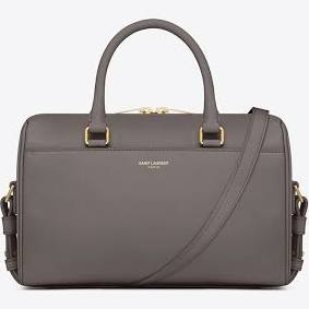 The Saint Laurent Duffle 6 bag is another one a girl can dream. Classic shape, long strap to wear it cross body, an outside pocket, and room to spare inside.Its particularly my favorite in grey or earth.